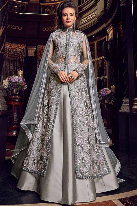 Outstanding grey designer lehenga style suit online which is crafted from net fabric with exclusive embroidery and stone work. This stunning designer lehenga style suit comes with silk bottom and net dupatta.