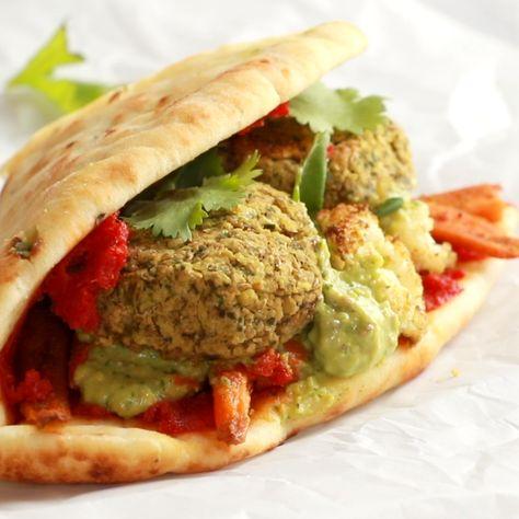 Naan-wich: 5 ingredient falafel, roasted veggies, and avocado sauce stuffed between pillowy garlic naan. Best sandwich recipe I've ever made. #vegetarian #veggie #sandwich #falafel #recipe | pinchofyum.com
