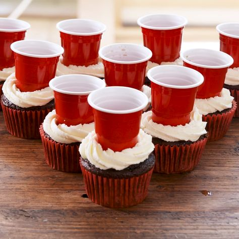 A dessert that doubles as a drinking game? Sign. Us. Up. You don't need much for this parter-starter, just cake mix, a can of coke, and some butter and sugar. We like rum & coke shots in ours, but feel free to swap out for your favorite cocktail. Don't forget to get yourself some shot glass solo cups and mini ping pong balls so your pong is actually playable. 😎 Get the recipe at Delish.com. #delish #easy #recipe #beerpong #cupcakes #partyideas #graduationpartyideas #gradparty #college