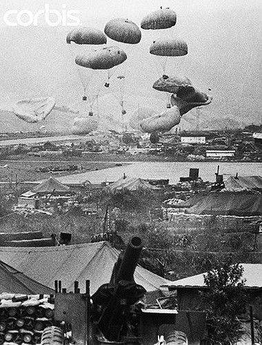 29 Feb 1968, Khe Sanh, South Vietnam --- 2/29/1968-Khe Sanh, South Vietnam: A load of supplies is parachuted into the beleaguered U.S. Marine stronghold at Khe Sanh. --- Image by © Bettmann/CORBIS