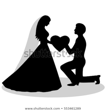 the bride and groom silhouette. The black silhouette of a bride and groom isolated on white background. Vector illustration.