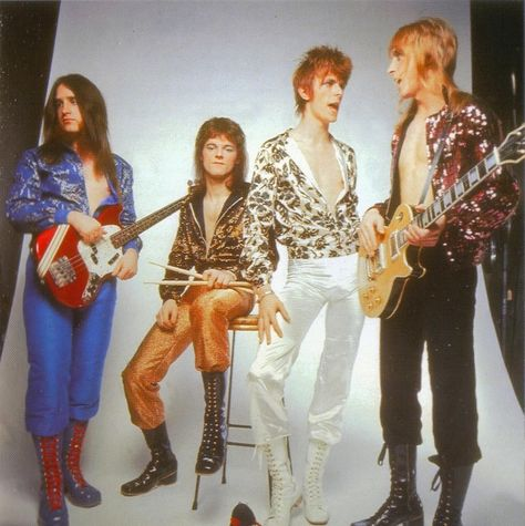 David Bowie, with his band, featuring Trevor Bolder from Uriah Heep, Mick…