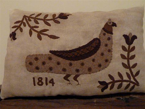 Fraktur style wool applique pillow.