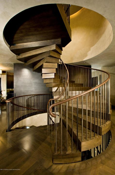 """A """"floating' staircase made of solid wood that took two years to build. A true piece of art and craftsmanship. Aspen, CO Coldwell Banker Mason Morse Real Estate $13,950,000"""