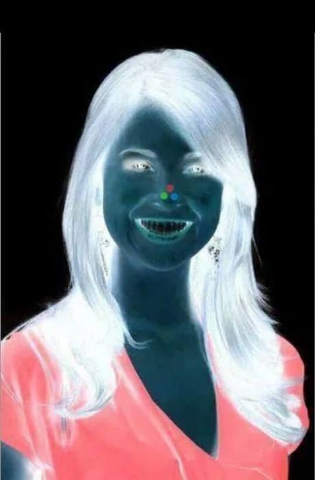 Stare at the red dot on her nose for 30 seconds and then look at a plain wall while blinking fast