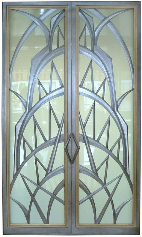 These highly customized decorative metal and glass doors were designed and created for a penthouse apartment in New York City with spectacular views of Manhattan, including the Chrysler Building. I was asked by the client to evoke the feel of that Art Deco icon