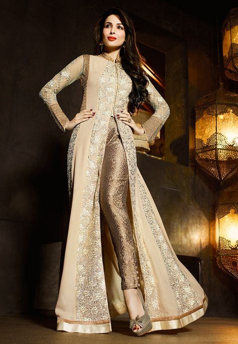 Attract compliments by this beige and cream georgette Malaika Arora Khan designer suit. The embroidered and patch border work looks chic and perfect for festival and wedding. Comes with matching botto.