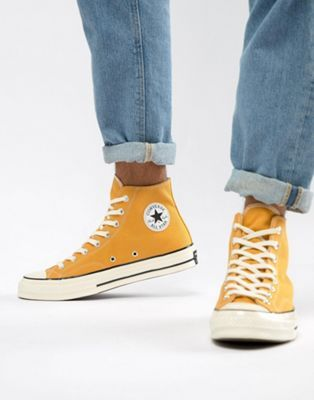 Converse All Star Chuck 70 high top plimsolls in yellow