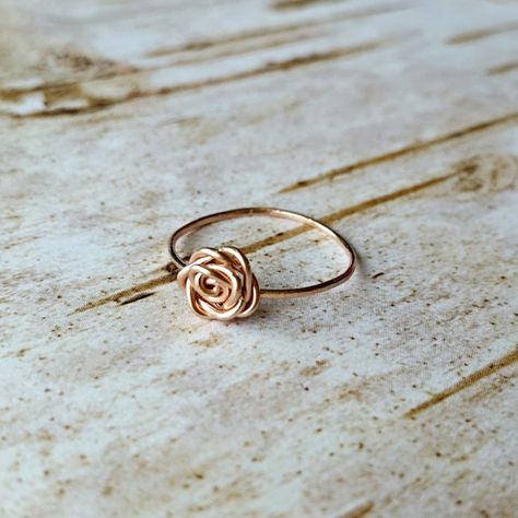 This little ring is so simple and beautiful and perfect for stacking. It is handmade with 14k rose gold fill and features a small rose as the focal. The band has been hammered for texture and strength and measures approximately 1mm wide. *Due to high demand this ring may take 5-7 days