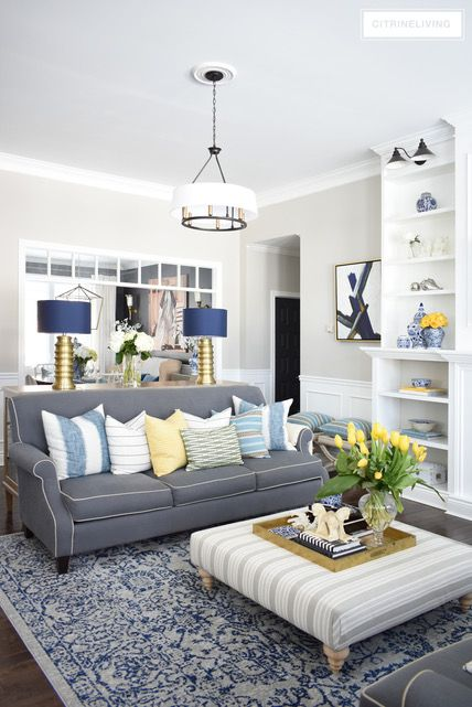 Elegant Spring Decorating Using Pretty Blue And Vibrant Yellow Accents Along With Real Yellow Living Room Blue And Yellow Living Room Yellow Decor Living Room
