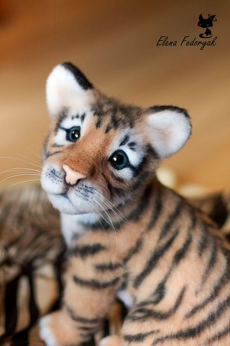 The tiger baby is approximately 30 cm tall, he weighted with glass granulate to make the toy more realistic, he has a wire frame in his tail, the