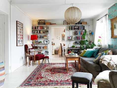Fun living room, large ceiling pendant, Persian style rug, red and turquoise furniture and accents....beautiful