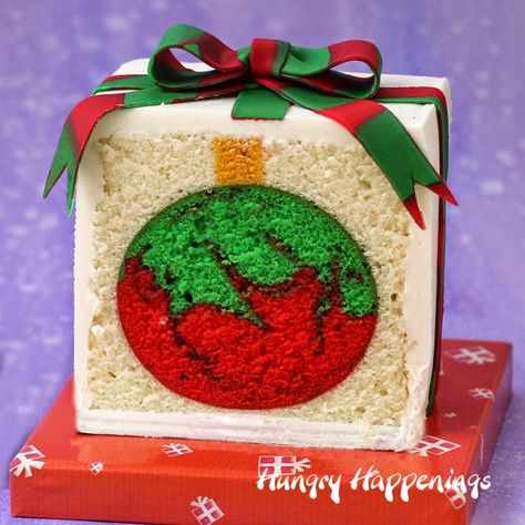 Surprise your kids by cutting into a Christmas present cake to reveal a red and green swirled ornament hiding inside!