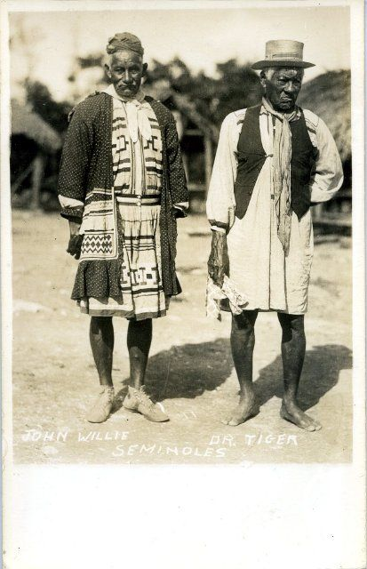 John Willie and Dr. Tiger Standing in a Seminole Village. Seminole Tribe of Florida Ah-Tah-Thi-Ki Museum