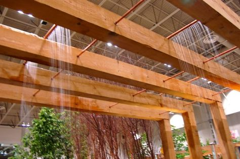 This rain-shower water feature is just one small detail of Kent Ford's simple but highly detailed garden. Look at the length of those beams! Repurposed, reclaimed, recycled and recyclable