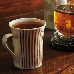 Make tea time chic with a gorgeous gold-lined infuser mug. Made of bone china, the decal design is striped with real gold. $19.95 at teavana.com.
