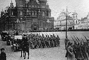 """Russian Revolution of 1917.jpg: Bolsheviks march on Red Square beginning the Civil War between """"Red"""" (Bolsheviks) and """"White"""" (anti Bolshevik) factions and led to the Abdication of Nicholas II, Collapse of the Imperial Government, Collapse of the Provisional Government, with the Bolsheviks utlimately victorious in establishing the USSR in 1922 - the first communist state."""