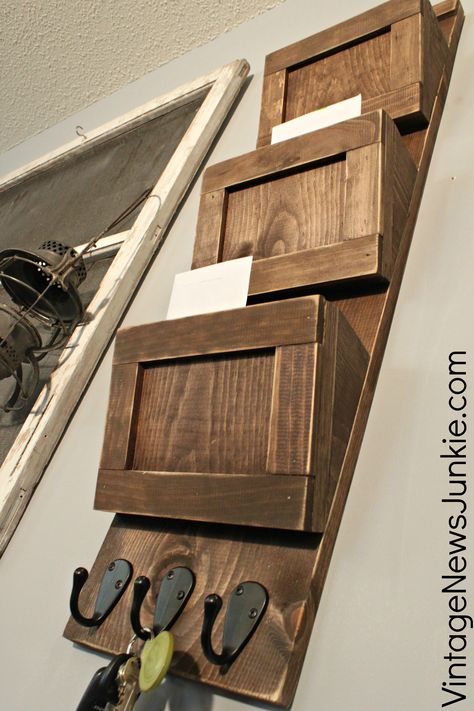 Build Your Own Wooden Mail Sorter {Video Tutorial}- Follow to Ana-white tutorial to build- and build directly onto command center board, using the extra board to make the slots. Stain all the same color- I like the dark walnut she chose.