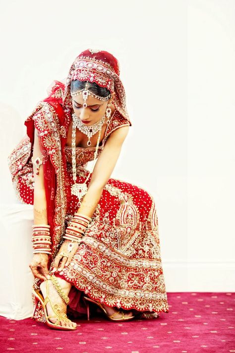 Traditional Red and gold Indian bridal Lengha.  Hindu wedding. Indian wedding