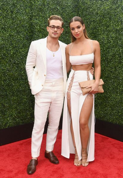Actor Dacre Montgomery (L) and model Liv Pollock attend the 2018 MTV Movie And TV Awards at Barker Hangar.