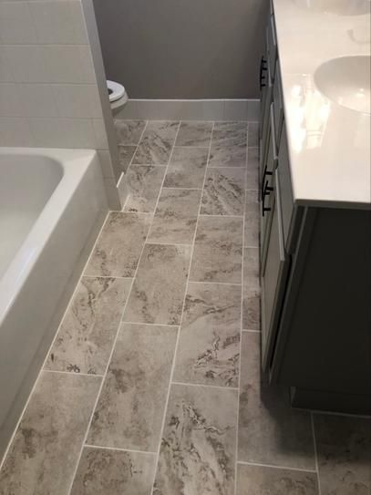 Trafficmaster Groutable 18 In X 18 In White And Grey Travertine Peel And Stick Vinyl Tile 36 Sq Ft C In 2020 Peel And Stick Vinyl Vinyl Tile Bathroom Vinyl Tile