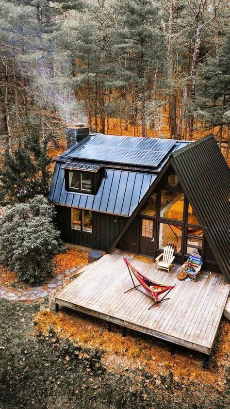 Who else wants to escape to this A-frame in the woods? | A-frame cabin with built on addition, nestled in the woods | Aframe inspo from Calmly Chaotic