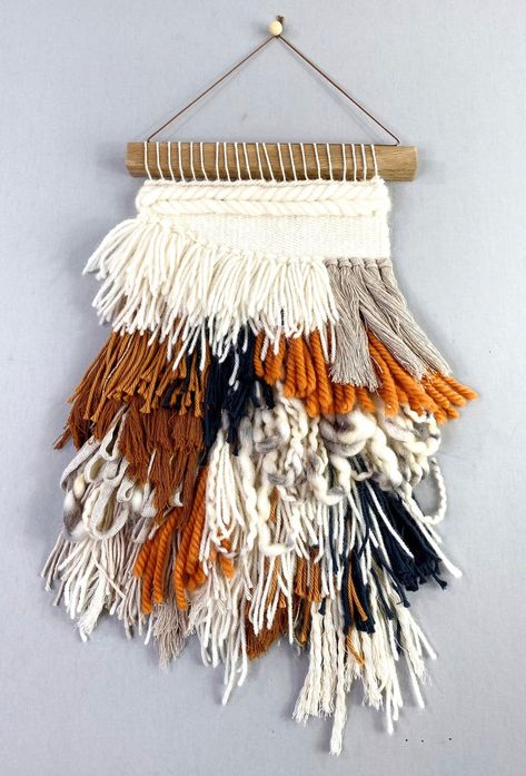 When wall decor and cozy knitwear meet, it's a perfect match in this knit wall hanging.