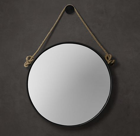 With its knotted jute rope and antiqued finish, our hand-crafted mirror exudes the aged warmth of a vintage find.        Its character reflects equally well on a rustic room or a modern loft, thanks to an oxidized black metal frame      The rope serves as a textured accent      Mirror hangs securely from a bracket on the back panel      Mounting hardware included      Simple assembly required