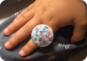 ring made from plastic milk or juice carton plug; found at Zakka Life