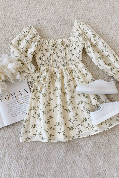 The Lulus Doting Over You Light Yellow Floral Print Smocked Mini Dress is a sweet summer staple! Style this dress with white sneakers for the perfect casual combo. Made of lightweight woven cotton and accented with stripes, swiss dots, white floral appliques, and a green leaf print, this smocked dress couldn't be more cute for a picnic. #lovelulus