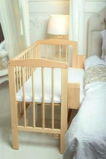 Co Sleep Crib All Sides Of The Crib Remain Intact Except For One Which Is Lowered Or Removed To Make The Mother Ac Wooden Baby Cot Baby Cot Bedding Bedside Cot