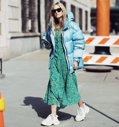 Love this cool blue puffer jacket worn over a green print midi dress and chunky sneakers - great fall outfit idea