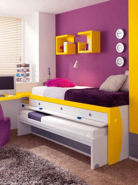 Living room with royal purple and yellow accents and comfortable furniture