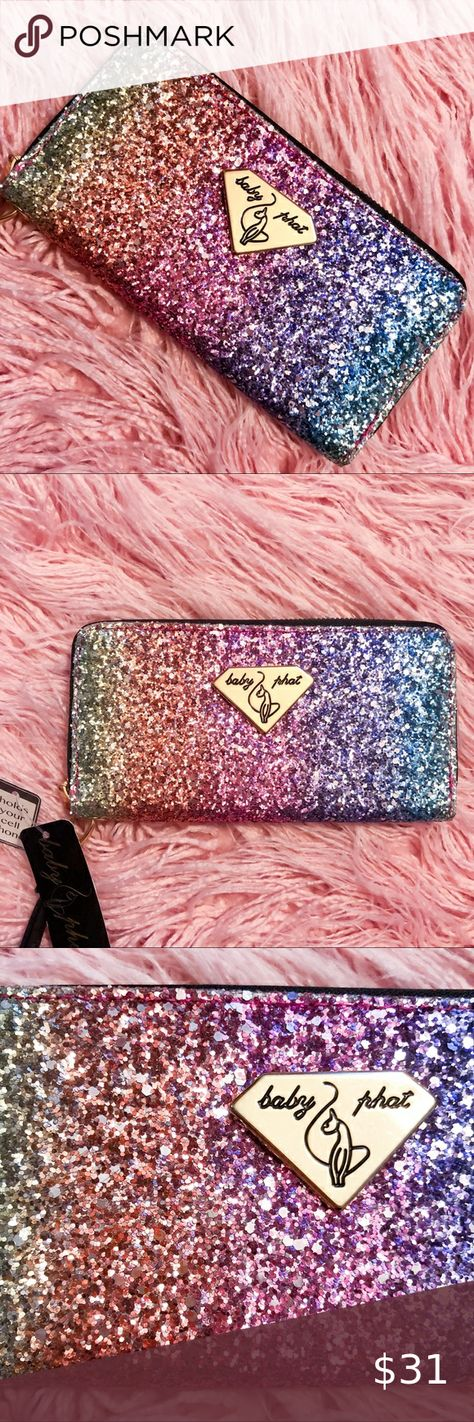 NWT Baby Phat rainbow glitter wallet New with tags Baby Phat sparkly rainbow wallet. This was an impulse buy that I'm not entirely mad at myself for frankly lmao. I kind of want to keep it cause it it rocks 😭 but I told myself I'd at least see if it sells. Gold hardware and wristlet strap. Fits an iPhone X easily  Y2k babyphat spangle spangly sequin sparkle glitter glittery pastel rainbow 2000s NWT wallets purse zip closure pouch clutch clubbing Barbie princess aesthetic pockets card holder str