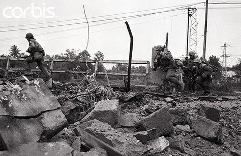 https://flic.kr/p/6F2KrC | BE020410 | 11 Feb 1968, Hue, South Vietnam --- US marines try to avoid gunfire as they cross a bridge in Hue, South Vietnam during the Vietnam War. --- Image by © Bettmann/CORBIS