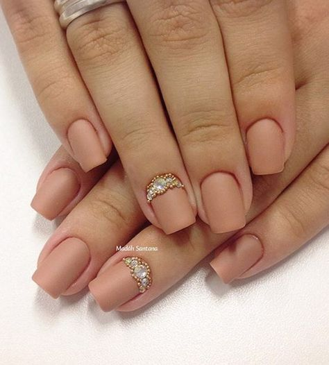 Matte nude nail art design with embellishments on top. Give your nude nails a statement y adding gold and silver beads on top to give a stunning effect.