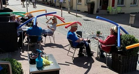 A cafe in Germany has required its customers to wear hats with pool noodles to ensure that they observe social distancing measures.