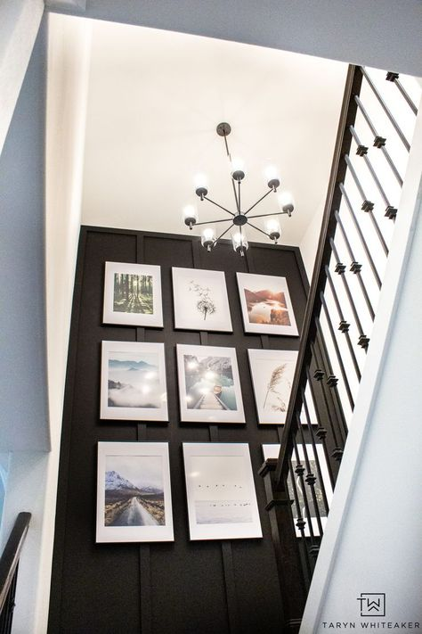 This custom gallery wall took a builder grade staircase into a custom modern look with a bold accent wall and oversized gallery wall using basic tools from HART Tools from Walmart!