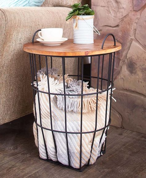 Add a sleek, modern touch to your home with this Wood Top Storage Basket Side Table. The dual-purpose piece offers a convenient table with a metal wire basket underneath for storing blankets, toys and so much more.