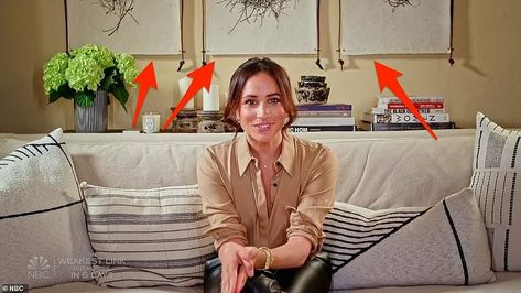 3. Monochrome artwork: Three large pieces of monchrome artwork can be seen directly behind Meghan's shoulder, which feature a bold black-and-white design. While the pieces are currently unidentified, it is a bolder design than the Duchess' usual choice, who often selects fine art for her home.