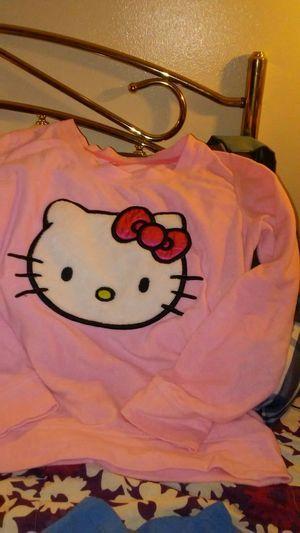 A Hello Kitty pj top & A Frozen tee shirt XL