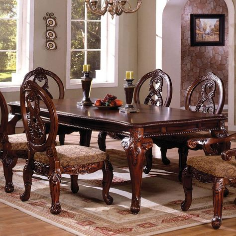 The rich details of the Tuscany II Dining Room Collection (Antique Cherry) by Furniture of America are the perfect setting for all of your special occasions. The elegant rectangular dining room table has romantic carvings on the French style legs.