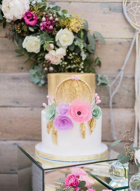 A gorgeous gold and feminine pastel baby shower two tiered cake for this private estate whimsical baby shower Laura Moll Nashville Photographer