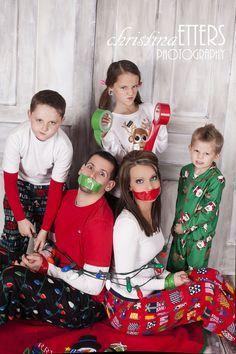 cute family christmas photo, kids take parents hostage