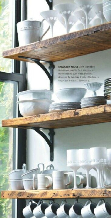 Barn wood or rustic shelving with black hardware for extra storage in kitchen…