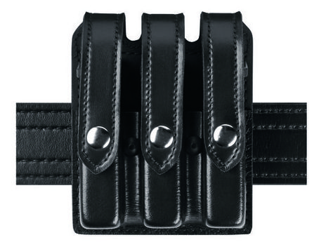 The Model 777 Triple Magazine Pouch is designed to carry two magazines on a 2.25 in. (58 mm) duty belt. The 777 features both vertical and horizontal belt slots, allowing it to ride in either a vertical or low-profile horizontal position. A magazine tension screw located between the two pouches allows for easy  retention adjustment. It's constructed of rugged SafariLaminate™ and is available in several scuff-resistant finishes with four different closures.