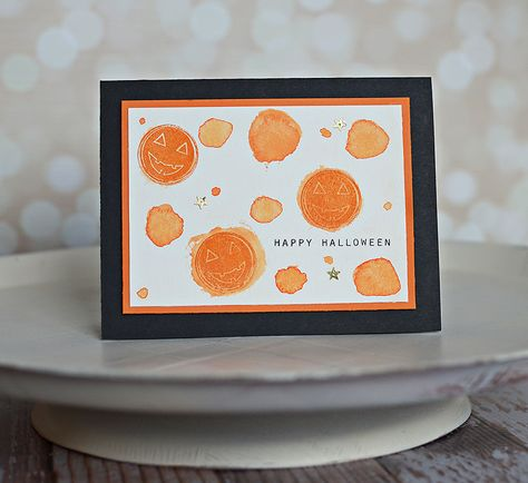 handmade card: Tuesday Ideas: Watercolor Halloween ...  cheerful watercolor circles ... pumpkin face resist ... formal framed look in orange and black ... great fun!