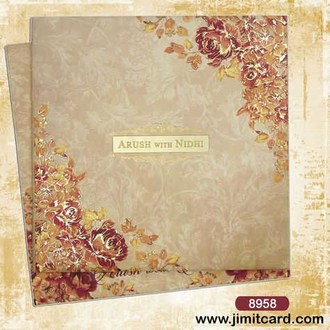 A Flower Themed #WeddingCard in light brown shade has flowers embossed on the bottom left and top right & a golden strip with reflecting surface where bride & groom names are written. Check out more on www.jimitcard.com