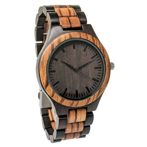 Description A stunning wooden watch, that is designed keeping class and simplicity in mind. The dial features a simple light wooded feature, that showcases the natural lines seen in wood. That is paired with a coffee colored dark base and touches of dark metal inside the dial. The perfect mixture of a casual and a formal design. That makes for the perfect addition to any watch collection. Let your groomsmen know that you appreciate their support on your special day, by gifting them this beautifu
