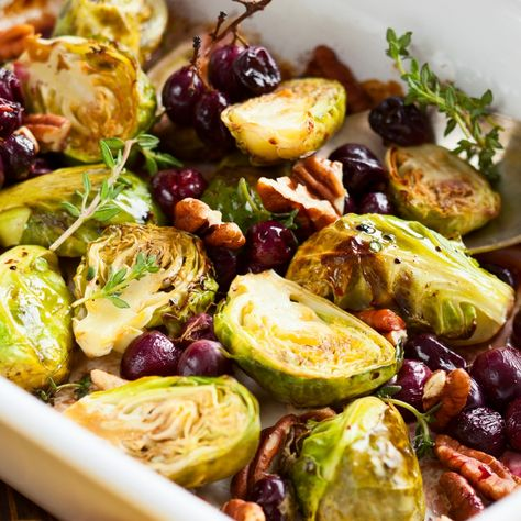These roasted Brussels sprouts are made with grapes and pecans. Serve topped with fresh thyme.. Roasted Brussels Sprouts Recipe from Grandmothers Kitchen.
